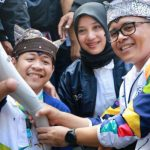 Zulkarnain, Photographer with Disabilities at The Asian Games in Banyuwangi